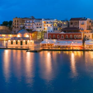 Picturesque panoramic view of Venetian quay of Chania with Kucuk Hasan Pasha Mosque during twilight blue hour, Crete, Greece